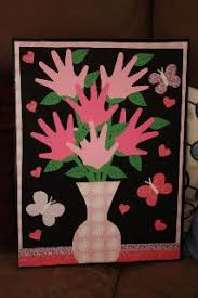 Valentine Scrapbook Paper And A Poster Frame Showcasing Kids Handprints As The Flowers