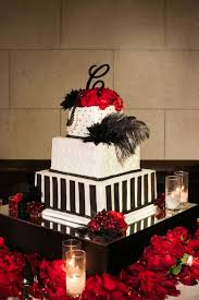 A Glam Black And White Wedding Cake Adorned With Feathers Red Roses