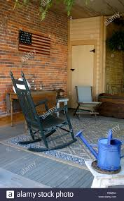 Old-fashioned Style Porch With Rocking Chair In Ohio, U.S.A ... Redwood Outdoor Rocker Handcrafted Wooden Prairie Leisure Garden Chair Patio Fniture For The Home Winston Vintage Wicker Blue Cushions Planters Rocking Chairs Explore Photos Of Old Fashioned Showing 12 10 Best Rocking Chairs Ipdent Buy Look Used For Sale Chairish Art Epicenters Austin Darrow Set Two