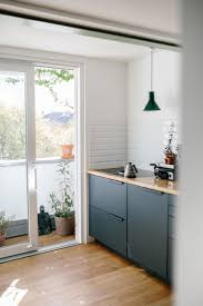 Sigurd Larsen Kitchen Design In Aluminium Anthracite With A Countertop Solid Oak Its