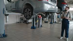 100 Car Elevator Garage Service Worker Standing With Tablet And Looking At Car Lifting Up By Automobile Elevator In The Repair Garage Stock Video Footage Storyblocks Video