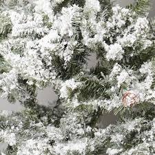 Christmas Tree Flocking Spray Uk by 5ft Lapland Flocked Christmas Tree With Pinecones Robert Dyas