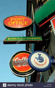 bureau de change nation cross post office and other signs including bureau de stock