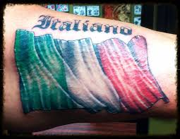 Wavy Italian Flag With The Word Italiano Above It In Old English LetteringTattoo Work By Vince Casale