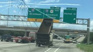 Dump Truck Locks Horns With Overhead Sign, Guess Who Wins
