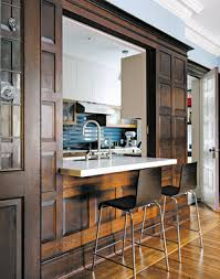 Here Is A Kitchen With An Open Countertop Into The Next Room In New York City
