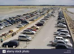car park at low tide mont st michel mount normandy stock