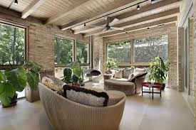 Sunroom Furniture Ideas With Round Rattan Wicker Sofas Side Table Under Ceiling Fan An Wooden Exposed Beam