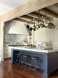Rectangular Pot Rack Over Blue Kitchen Island