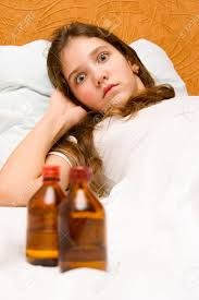 portrait of cute teen ill in bed stock photo picture and