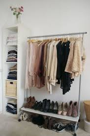 clothes rack with bottom shelf organizing with useful clothes