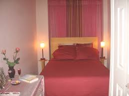 Set Of Bedside Table Lamps by Red Bedding Set And Twin Table Lamps On Small Brown Wooden Bedside