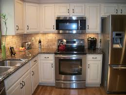Backsplash Ideas White Cabinets Brown Countertop by Kitchen Designs Tropic Brown Granite Countertops With White