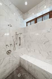 Marvelous Carrera Marble Bathroom With Shower Head And Ceiling Lighting