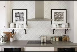 breathtaking light gray kitchen backsplash using herringbone tile