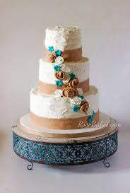Edible Burlap Ribbon And Roses On A Rustic Buttercream Cake