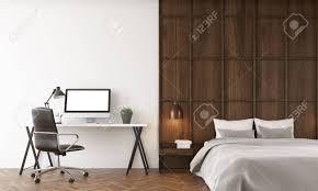 komfortables schlafzimmer mit einem großen bett und schreibtisch computer auf dem tisch 3d übertragen attrappe lehrmodell simulation
