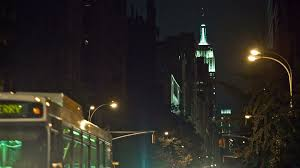 Empire State Building lights at night view from Lower 5th Ave with