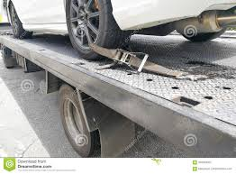 Car Tire Secured With Safety Belt On Flatbed Tow Truck Stock Image ...