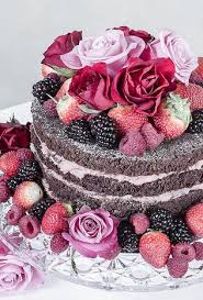 Naked chocolate cake with flowers and fruit what a beautiful display and it looks so