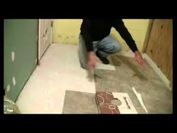 Vinyl Floor Underlayment On Concrete by How To Tile Concrete Floors With Self Adhesive Vinyl Tiles Youtube