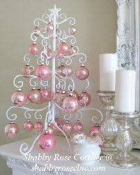 Pretty Pink Christmas Ornaments On A Lovely White Ironwork Holiday Tree