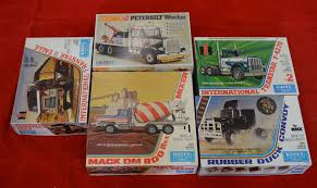 Five Plastic Model Truck Kits By Matchbox And Ertl. All Appear ... Tamiya 56348 Actros Gigaspace 3363 6x4 Truck Kit Astec Models Ford F150 The Crittden Automotive Library Toyota Hilux Highlift Electric 4x4 Scale Truck Kit By Meccano New Set 4x4 Building Sets Kits Baby Revell 1937 Panel Delivery 854930 125 Plastic Italeri 124 3899 Iveco Stralis Hiway Model Deans Hobby Stop Colctable Model Car Motocycle Kits 300056335 Mercedes Benz 1851 Gigaspace 114 07412 Peterbilt 359 From Kh