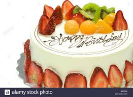 Tasty colorful fruit cake with happy birthday on it