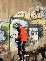 Big Ang Mural Brooklyn by Nike Orange Sweatshirt Adidas Pants Graffiti Wall The World