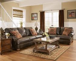truffle color rustic living room with nailhead deatils by ashley 85601