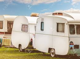 100 Restored Travel Trailer Row Of Three Vintage Restored Caravans In Front Of A Blue Sky