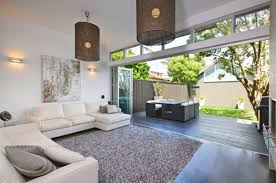 Use Complimenting Flooring Between Your Living Room And The Outside To Make Transition Seamless Once Doors Are Opened