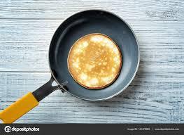 cuisine preparation preparation of pancakes on pan top view stock photo belchonock