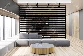 schwarzer wohnzimmerinnenraum mit einer schwarzen hölzernen wand einem konkreten boden einem grauen sofa und einem runden couchtisch 3d rendering
