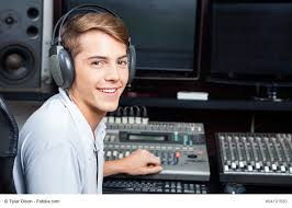 Handsome Man Mixing Audio In Recording Studio