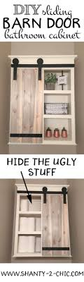 DIY Sliding Barn Door Bathroom Cabinet | Toilets, Open Shelving ... Bar Sliding Barn Door Plans Best 25 Modern Barn Doors Ideas On Pinterest Sliding Design Designs Interior Ideasbarn Closet Building Space Saving And Creative Doors Dutch How To Build Page Learn About Remodelaholic Simple Diy Tutorial Front Overhang Ideas Tape Guide Cross Fake Garage Windows Diy Vinyl Free From Barntoolboxcom For The Farmhouse Small Hdware And