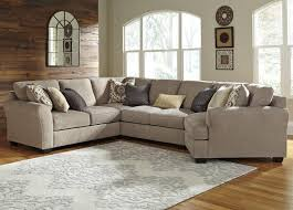 4 piece sectional with right cuddler by benchcraft wolf and