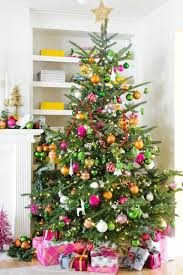 A Usual Christmas Tree Decorated In Orange Raspberry And Sage Colors