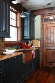 Rustic Kitchen With Blue Cabinets Hoods