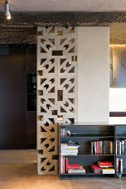 Ornate Concrete Blocks Screen A Storage Area In The Kitchen While Letting Light Through