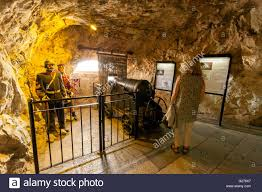 the great siege a tourist inside the great siege tunnels gibraltar europe stock