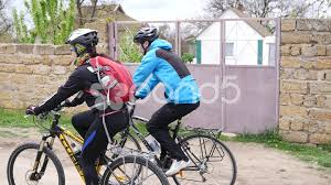 Friends Riding On A Bicycle Countryside Rout