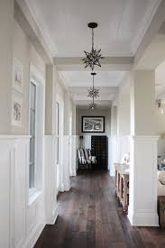 Moravian Star Light Fixtures Neutral Hallway With Black And White Accents
