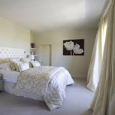 Inspiration For A Timeless Master Carpeted Bedroom Remodel In Dublin With Beige Walls