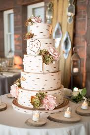 White Wedding Cake Made To Resemble A Birch Tree With The Couples Initials Carved On It