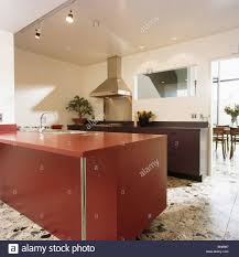 Red Fitted Unit In Large Modern White Kitchen With Terrazzo Flooring