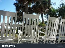 Low Angle Rocking Chairs On Deck Stock Photo (Edit Now) 122708839 ... Fniture Interesting Lowes Rocking Chairs For Home Httpporch Cecilash Wp Front Porch Good Looking Chair Havana Cane Cushion Shop Garden Tasures Black Wood Slat Seat Outdoor Nemschoff 11 Best Rockers Your Style Selections With At Lowescom Florida Key West Keys Old Town Audubon House Tropical Gardens White Lane Decor Hervorragend Glider Recliner Desig Cushions Outside Modern Cb2 Composite By Type Trex Lucca Acacia
