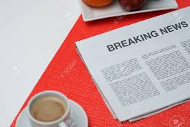 Breaking News Article In The Newspaper At Home Stock Photo