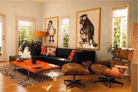 Brown Couch Decor Living Room by Dark Brown Couch Orange Accents Side Chair And Ottaman Lamp And