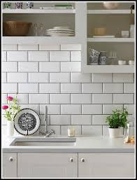 white subway tile backsplash with white grout tiles home